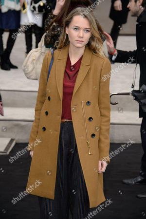 Stock Photo of Imogen Waterhouse poses for photographers upon arrival at the Burberry Prorsum fashion show in London