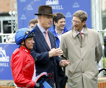 Frankie Dettori with John Gosden and Chris Richardson of Cheveley Park Stud after Juliet Capulet had won the Shadwell Rockfel Stakes at Newmarket.