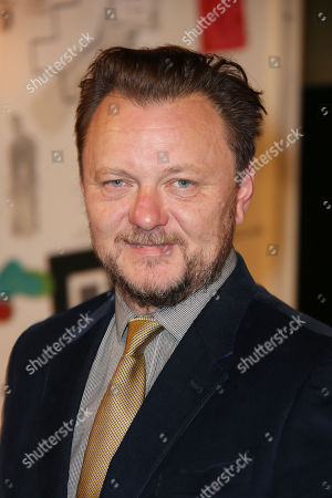 Writer John Niven poses for photographers upon arrival at the UK premiere of Kill Your Friends, at a central London cinema