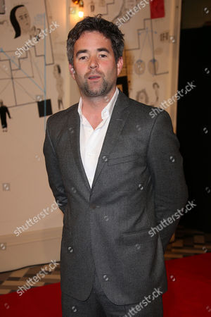 Director Owen Harris poses for photographers upon arrival at the UK premiere of Kill Your Friends, at a central London cinema