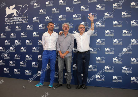 Stock Photo of From left, producer Matthieu Tarot, director Christian Vincent, and actor Fabrice Luchini pose for photographers at the photo call for the film L'Hermine during the 72nd edition of the Venice Film Festival in Venice, Italy