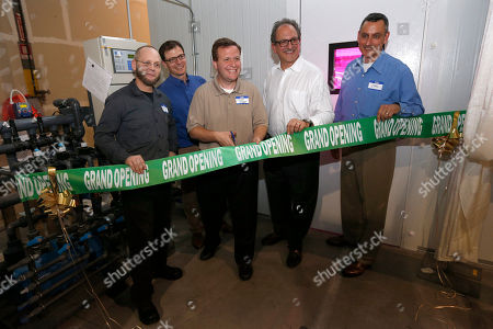 Left to Right) Lane Patterson, Rob Schlyer, Portage Mayor James Snyder, Robert Colangelo, founder and Carl Wenz CFO of Green Sense Farms cuts the Grand Opening ribbon at the Green Sense Farms Grand Opening,, in Portage, Ind