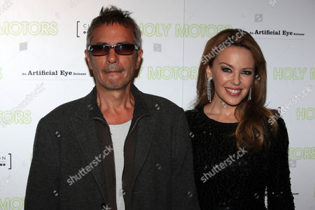 Director Leos Carax, left, and Kylie Minogue are seen at the UK premiere of 'Holy Motors' at the Curzon Mayfair on in London, UK