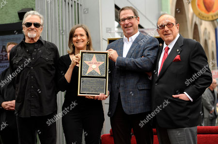 Michael Joplin, second from right, and Laura Joplin, siblings of late singer Janis Joplin, pose with singer Kris Kristofferson, far left, and record industry executive Clive Davis at a ceremony honoring Joplin with a posthumous star on the Hollywood Walk of Fame, in Los Angeles