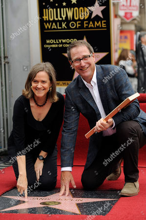 Laura and Michael Joplin, siblings of the late singer Janis Joplin, touch her star at a ceremony honoring Joplin with a posthumous star on the Hollywood Walk of Fame, in Los Angeles
