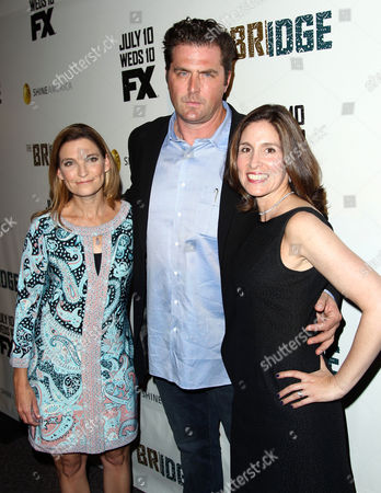 "Elwood Reid, center, Carolyn Bernstein, right, and Meredith Stiehm pose together at the premiere screening of ""The Bridge"" at the DGA Theatre on in Los Angeles"