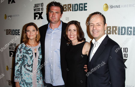 "From left, Meredith Stiehm, Elwood Reid, Carolyn Bernstein, and John Landgraf pose together at the premiere screening of ""The Bridge"" at the DGA Theatre on in Los Angeles"