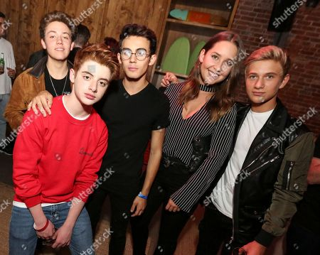 Stock Photo of Ethan Cutkosky, Thomas Barbusca, Tyler Alvarez, Thomas Kuc. Ethan Cutkosky, from left, Thomas Barbusca, Tyler Alvarez and Thomas Kuc at Xbox Playdate with James Corden at The Microsoft Lounge on in Venice, Calif