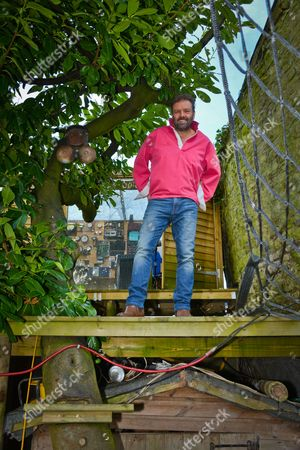 Martin Roberts - My Haven his Radio Station Tree House studio near Bristol. 24.1.2017 UFO Interceptor Dinky Toy Jungle Hat and Notes from 'I'm a Celeb' Frame Photos of: Wedding to Kirsty, with Kirsty & kids Megan & Scott, with Lucy Alexander & Fav cameramen Mark Moreve. Car Steering wheel (all that's left of his car) From his MGB Roadster Survival Kit he made when he was !0 yrs old Jar of Sand & Seawater, from a beach in Hawaii, where Mitzi Gaynor  sang ' I'm going to wash that man right out of my hair' (Martin is a Travel Journalist) Kilimanjaro Beer - where he met wife Kirsty Beano - 'Homes under the Hammer' gets a mention