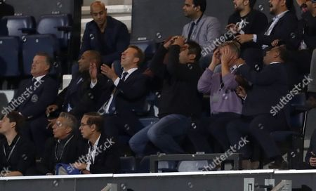 QPR owner Tony Fernandes (far right), Lee Hoos and Les Ferdinand all turn away in frustration