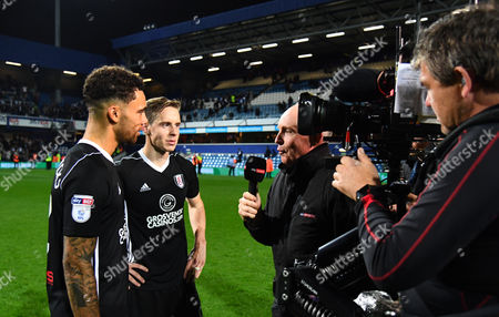 Stefan Johansen and Ryan Fredericks of Fulham are interviewed by David Craig of Sky Sports at full time