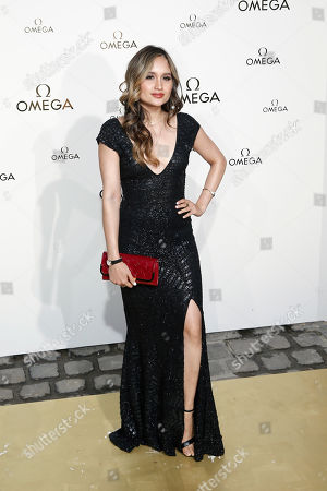 Stock Image of Actress Cinta Laura Kiehl poses for photographers upon arrival at a party for Omega in Paris