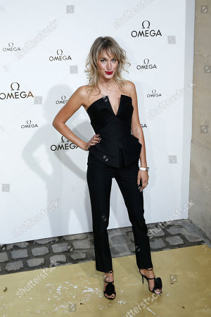 Actress Pauline Lefevre poses for photographers upon arrival at a party for Omega in Paris