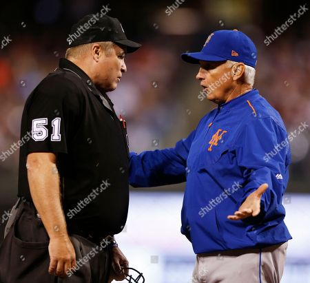 Terry Collins, Marvin Hudson, Hansel Robles. New York Mets manager Terry Collins, right, argues with umpire Marvin Hudson (51) after a warning was given to relief pitcher Hansel Robles in the sixth inning of a baseball game against the Philadelphia Phillies, in Philadelphia