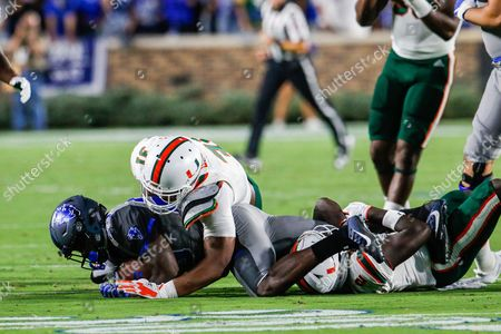 Shaun Wilson (29) of the Duke Blue Devils gets taken down by Trajan Bandy (2) of the Miami Hurricanes in the NCAA matchup between Miami and Duke at Wallace Wade Stadium in Durham, NC
