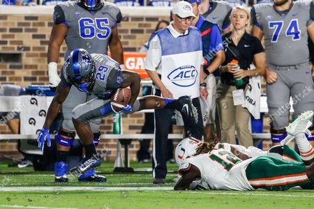 Shaun Wilson (29) of the Duke Blue Devils tiptoes down the sideline for extra yards in the second quarter of the NCAA matchup between Miami and Duke at Wallace Wade Stadium in Durham, NC