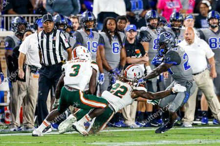 Sheldrick Redwine (22) of the Miami Hurricanes cannot get Shaun Wilson (29) of the Duke Blue Devils in the third quarter of the NCAA matchup between Miami and Duke at Wallace Wade Stadium in Durham, NC