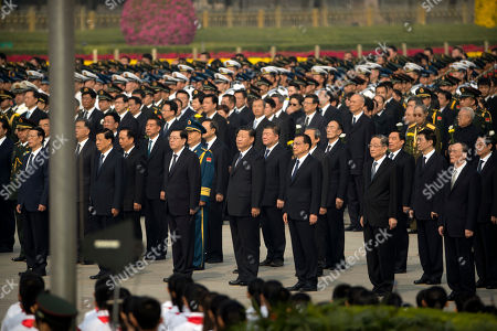 Stock Picture of Zhang Gaoli, Liu Yunshan, Zhang Dejiang, Xi Jinping, Li Keqiang, Yu Zhengsheng, Wang Qishan. Members of China's Politburo Standing Committee, front row from left, Zhang Gaoli, Liu Yunshan, Zhang Dejiang, Chinese President Xi Jinping, Premier Li Keqiang, Yu Zhengsheng, and Wang Qishan attend a ceremony marking Martyrs' Day at Tiananmen Square in Beijing, . Xi and other Chinese leaders presented flower baskets and scores of ordinary people filed up to lay a single flower each on Saturday at the monument to mark Martyrs' Day