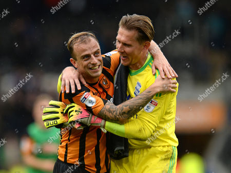 Kamil Grosicki of Hull City shares a joke with Tomasz Kuszczak of Birmingham City after the final whistle