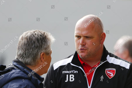Jim Bentley, Manager of Morecambe speaks to Steve Perryman, Director of football of Exeter City during the Sky Bet League 2 Match between Exeter City and Morecambe at St James Park, Exeter, Devon on September 30.