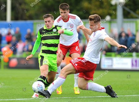 Tyler Hornby-Forbes of Accrington Stanley tackles Charlie Cooper of Forest Green Rovers
