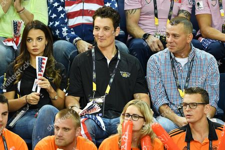 Keleigh Sperry, Miles Teller and Adam Schumann watch the wheelchair basketball finals during day eight of the Invictus Games at Mattamy Athletics centre.