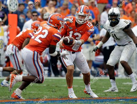 Florida quarterback Feleipe Franks (13) hands off the ball to Florida running back Lamical Perine (22) as Vanderbilt linebacker Charles Wright (11) comes in for the play during the second half of an NCAA college football game, in Gainesville, Fla. Florida won 38-24