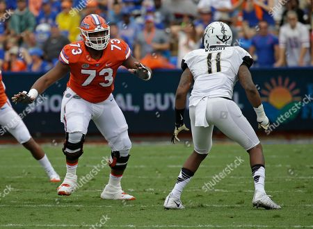 Florida offensive lineman Martez Ivey (73) looks to block Vanderbilt linebacker Charles Wright (11) during the first half of an NCAA college football game, in Gainesville, Fla