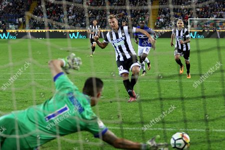 Stock Photo of Udinese's forward Maxi Lopez (C) scores the 2-0 by penalty during the Italian Serie A soccer match Udinese Calcio vs UC Sampdoria at Friuli stadium in Udine, Italy, 30 September 2017.