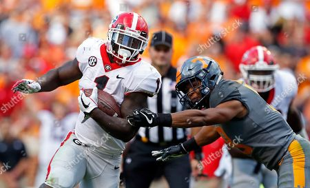 Sony Michel, Justin Martin. Georgia running back Sony Michel (1) outruns Tennessee defensive back Justin Martin (8) in the second half of an NCAA college football game, in Knoxville, Tenn. Georgia won 41-0