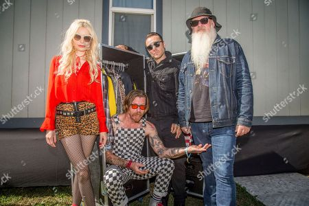 Jennie Vee, Jesse Hughes, Jorma Vik, Dave Catching. Jennie Vee, from left, Jesse Hughes, Jorma Vik and Dave Catching of Eagles of Death Metal pose at the Louder Than Life Music Festival at Champions Park, in Louisville, Ky