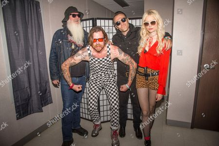Dave Catching, Jesse Hughes, Jorma Vik, Jennie Vee. Dave Catching, from left, Jesse Hughes, Jorma Vik and Jennie Vee of Eagles of Death Metal pose at the Louder Than Life Music Festival at Champions Park, in Louisville, Ky