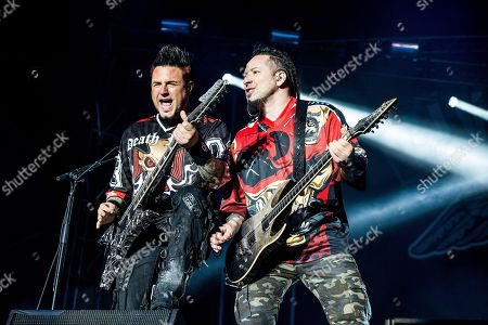 Zoltan Bathory, Jason Hook. Zoltan Bathory, left, and Jason Hook of Five Finger Death Punch perform at the Louder Than Life Music Festival at Champions Park, in Louisville, Ky
