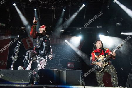Ivan L. Moody, Zoltan Bathory. Ivan L. Moody, left, and Zoltan Bathory of Five Finger Death Punch performs at the Louder Than Life Music Festival at Champions Park, in Louisville, Ky