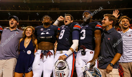 Nate Craig-Myers, Jarrett Stidham, Kyle Davis. Auburn quarterback Jarrett Stidham (8), wide receiver Kyle Davis (11), and wide receiver Nate Craig-Myers (3) celebrate with fans after defeating Mississippi State 49-10 in an NCAA college football game, in Auburn, Ala