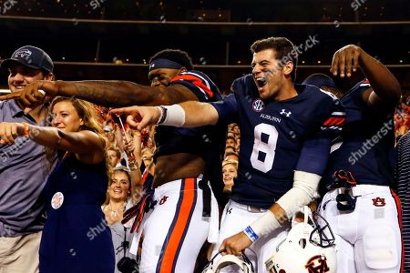 Jarrett Stidham, Kyle Davis. Auburn quarterback Jarrett Stidham (8) and Auburn wide receiver Kyle Davis (11) celebrate with fans after defeating Mississippi State 49-10 in an NCAA college football game, in Auburn, Ala