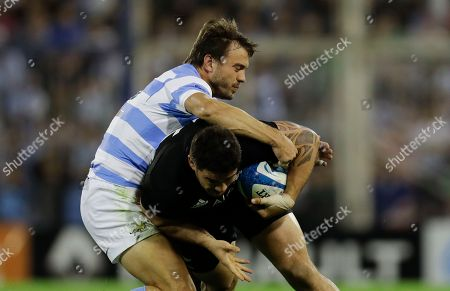 New Zealand's All Blacks hooker Codie Taylor, below, is tackled by Argentina's Los Pumas flyhalf Juan Martin Hernandez during a rugby Championship match in Buenos Aires, Argentina