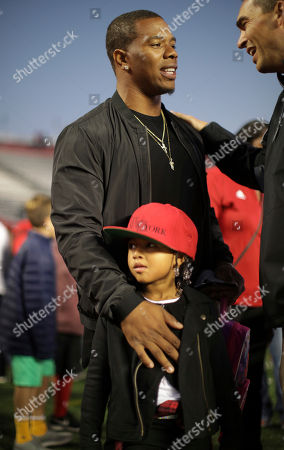Former Rutgers football standout and NFL player Ray Rice stands on the sideline before an NCAA college football game, in Piscataway, N.J