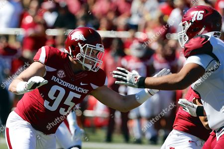 Razorback defensive end Jake Hall #95 works to avoid a blocker. The Arkansas Razorbacks defeated the New Mexico State Aggies 42-24 at Donald W. Reynolds Stadium in Fayetteville, AR, Richey Miller/CSM