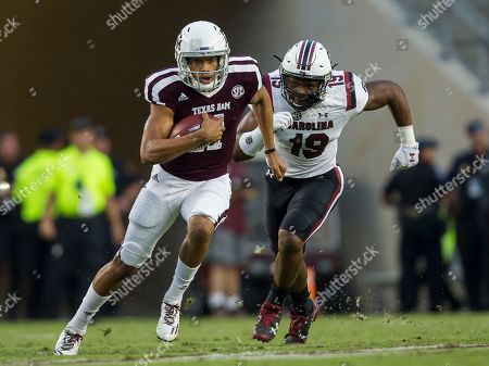 Kellen Mond, Brad Johnson. Texas A&M quarterback Kellen Mond (11) evades a tackle by South Carolina defensive lineman Brad Johnson (19) during the first quarter of an NCAA college football game, in College Station, Texas
