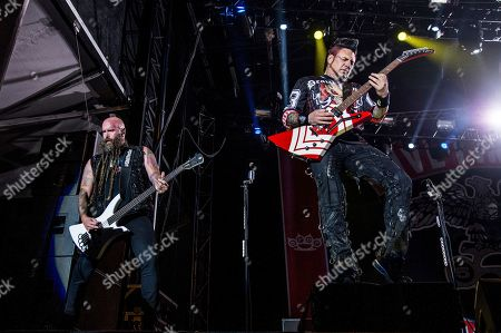 Jason Hook, Chris Kael. Chris Kael, left, and Jason Hook of Five Finger Death Punch perform at the Louder Than Life Music Festival at Champions Park, in Louisville, Ky
