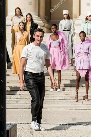 Guillaume Henry and models on the catwalk