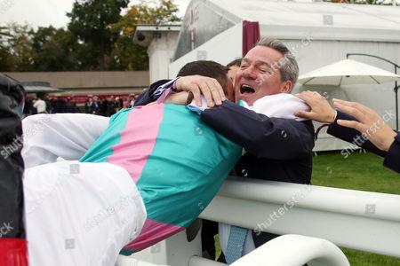 , Chantilly, Frankie Dettori hugs Michael Hills after winning the Qatar Prix de L'Arc de Triomphe.