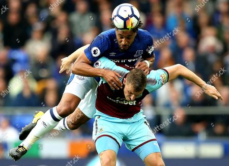 Ashley Williams of Everton challenges for a header with Chris Woods of Burnley