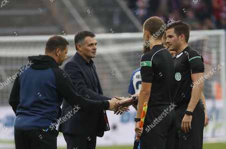 Berlin's head coach Pal Dardai (L) and Bayern's coach Willy Sagnol (2-L) shake hands with referee Harm Osmers (R) after the German Bundesliga soccer match between Hertha BSC and FC Bayern Munich in Berlin, Germany, 01 October 2017.