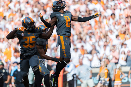 Justin Martin #8 of the Tennessee Volunteers and teammates celebrate his interception during the NCAA Football game between the University of Tennessee Volunteers and the University of Georgia Bulldogs at Neyland Stadium in Knoxville, TN Tim Gangloff/CSM
