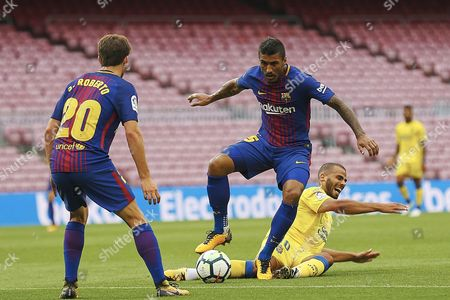 """FC Barcelona´s Brazilian midfielder Jose Paulo Bezerra 'Paulinho' (c) figths fot the ball with Moroccan Oussama Tannane (R) of UD Las Palmas during the Spanish Primera Division match FC Barcelona vs UD Las Palmas, 01 October 2017 in Barcelona, Spain. The board of the FC Barcelona decided to play behind closed doors. The club released a statement on their official website which reads: """"FC Barcelona condemns the events which have taken place in many parts of Catalonia today in order to prevent its citizens exercising their democratic right to free expression. Given the exceptional nature of events, the Board of Directors have decided that the FC Barcelona first-team game against Las Palmas will be played behind closed doors following the Professional Football League's refusal to postpone the game."""""""