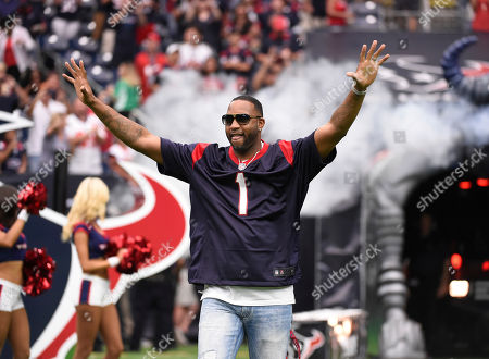 Former Houston Rockets player Tracy McGrady is introduced as honorary captain prior to an NFL football game, in Houston