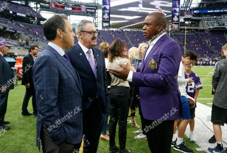 Stock Photo of Ahmad Rashad, Mark Wilf, Zygi Wilf. Former Minnesota Vikings wide receiver Ahmad Rashad, right, talks with Vikings owners Mark, left, and Zygi Wilf before an NFL football game, in Minneapolis