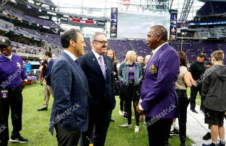 Stock Image of Ahmad Rashad, Mark Wilf, Zygi Wilf. Former Minnesota Vikings wide receiver Ahmad Rashad, right, talks with Vikings owners Mark, left, and Zygi Wilf before an NFL football game, in Minneapolis